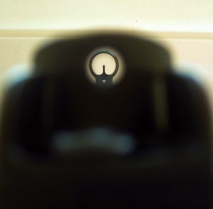 Looking through the aperture sight of an H&K MP5.